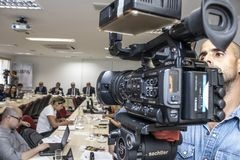 Photographers and journalists at press conference in Sao Paulo city, Brazil. Sao Paulo, Brazil, December 13, 2018. Photographers and journalists at press stock photos