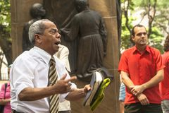 Evangelical preacher. Sao Paulo, Brazil, January 09, 2009. Man evangelical preacher explains God's Word in Se Square in downtown Sao Paulo royalty free stock photos