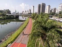 View of buildings, CPTM train, traffic of vehicles and river in Marginal Pinheiros River Avenue royalty free stock photography