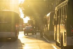 Bus and pedestrian movement, on a late afternoon, on Sao Joao Avenue stock images