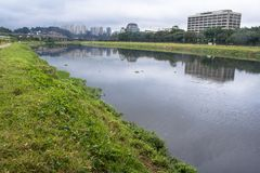 Pollution Pinheiros River. Sao Paulo, Brazil, June 01, 2008. Pollution of Pinheiros river by sewage and trash of city in a rain day royalty free stock image