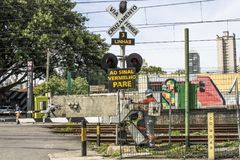 Railroad traffic Light. Sao Paulo, Brazil, March 10, 2017. Level crossing between the street and railroad with traffic light and write to the red stop sign in Royalty Free Stock Photography