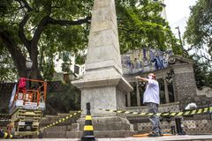 Work to clean vandalism graffiti, waterproof and restore the Obelisco da Memoria stock photo