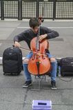 Male cellist performing a classical concert in the street at Paulista Avenue. Sao Paulo, Brazil November 24, 2018: An unidentified male cellist performing a stock photo