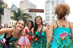 Sao Paulo, Brazil - October, 20 2017. Costumed women are having fun in outdoor event. Sao Paulo, Brazil - October, 20 2017. Known as Peruada, it is the Stock Photo