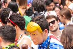 Sao Paulo, Brazil - October, 20 2017. Reveler uses Donald Trump`s mask on event. Carnival. Sao Paulo, Brazil - October, 20 2017. Known as Peruada, it is the Stock Photo