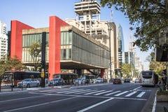 The sao paulo museum of art. Sao Paulo, Brazil, September 20, 2017. Traffic jam and facade of The Sao Paulo Museum of Art in Portuguese, Museu de Arte de Sao Royalty Free Stock Photos