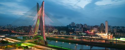 Sao Paulo city bridge at night. Scenic view of Octavio Frias de Oliveira bridge illuminated at night over Pinheiros river in Sao Paulo, Brazil Royalty Free Stock Photography