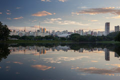 Sao Paulo cityscape. A reflected sunset over a lake in Ibirapuera park in Sao Paulo city, Brazil stock photos