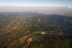 Sao Paulo Metropolis. A forest in the first plane and the large urban area of the metropolis of Sao Paulo spreading up to the horizon Stock Photography