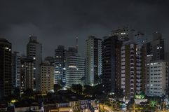 Sao Paulo at night. Buildings of Sao Paulo city at a cloudy night. Urban photo of the city during night royalty free stock photos