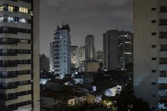 Sao Paulo at night. Buildings of Sao Paulo city at a cloudy night. Urban photo of the city during night stock image