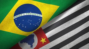 Sao Paulo state and Brazil flags textile cloth, fabric texture. Sao Paulo state and Brazil folded flags together royalty free illustration