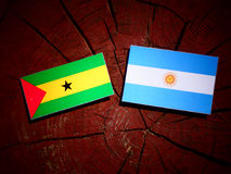 Sao Tome and Principe flag with Argentinian flag on a tree stump Stock Images