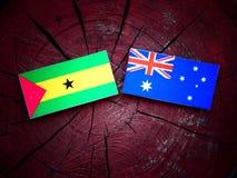 Sao Tome and Principe flag with Australian flag on a tree stump. Sao Tome and Principe flag with Australian flag on a tree stump Stock Photos