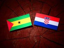 Sao Tome and Principe flag with Croatian flag on a tree stump is. Olated Royalty Free Stock Image