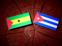 Sao Tome and Principe flag with Cuban flag on a tree stump isola. Ted Royalty Free Stock Photography