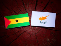 Sao Tome and Principe flag with Cypriot flag on a tree stump iso. Lated Royalty Free Stock Image