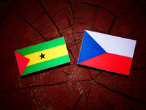 Sao Tome and Principe flag with Czech flag on a tree stump isola Royalty Free Stock Photography