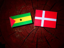 Sao Tome and Principe flag with Danish flag on a tree stump isol. Ated Royalty Free Stock Image