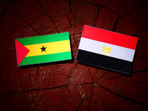 Sao Tome and Principe flag with Egyptian flag on a tree stump is. Olated Royalty Free Stock Photography