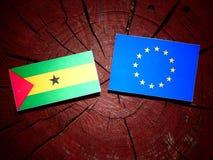 Sao Tome and Principe flag with EU flag on a tree stump isolated. Sao Tome and Principe flag with EU flag on a tree stump Royalty Free Stock Image