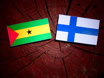 Sao Tome and Principe flag with Finnish flag on a tree stump iso. Lated Royalty Free Stock Photography