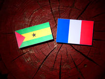 Sao Tome and Principe flag with French flag on a tree stump isol. Ated Stock Photos