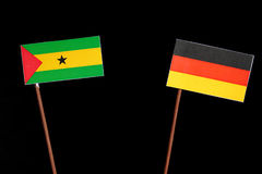 Sao Tome and Principe flag with German flag  on black. Background Royalty Free Stock Photos