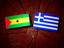 Sao Tome and Principe flag with Greek flag on a tree stump isola. Ted Stock Image