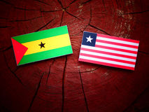 Sao Tome and Principe flag with Liberian flag on a tree stump is. Olated Royalty Free Stock Photo