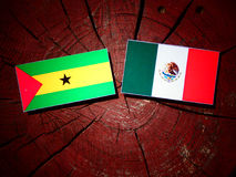 Sao Tome and Principe flag with Mexican flag on a tree stump iso. Lated Royalty Free Stock Photo
