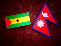 Sao Tome and Principe flag with Nepali flag on a tree stump isol. Ated Stock Photos