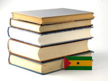 Sao Tome and Principe flag with pile of books isolated on white. Background Stock Photo