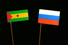 Sao Tome and Principe flag with Russian flag  on black. Background Royalty Free Stock Images