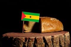 Sao Tome and Principe flag on a stump with bread.  Stock Image