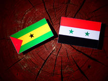 Sao Tome and Principe flag with Syrian flag on a tree stump isol. Ated Stock Photo