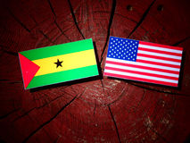 Sao Tome and Principe flag with USA flag on a tree stump isolate. D Stock Images
