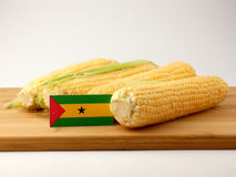 Sao Tome and Principe flag on a wooden panel with corn isolated. On a white background Royalty Free Stock Photos