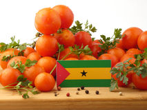 Sao Tome and Principe flag on a wooden panel with tomatoes isola. Ted on a white background Royalty Free Stock Images