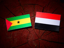 Sao Tome and Principe flag with Yemeni flag on a tree stump isol. Ated Royalty Free Stock Images