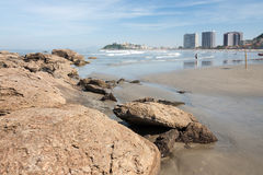 Sao Vicente Brazil Gonzaguinha. Gonzaguinha beach with its large rocks in Sao Vicente at the shore of the Atlantic Ocean, Sao Paulo state Royalty Free Stock Photos