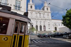 Sao Vicente de Fora Monastery Alfama - Yellow tram in foreground Royalty Free Stock Image