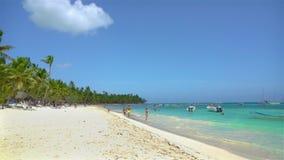Saona, Dominican Republic - June 18, 2018: tourists enjoy beaytiful ocean beach on Saona island. stock video