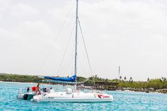 SAONA, DOMINICAN REPUBLIC - MAY 25, 2017: Sailing yacht on the shore of the island Saona. Copy space for text. SAONA, DOMINICAN REPUBLIC - MAY 25, 2017: Sailing Royalty Free Stock Photos