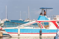 SAONA, DOMINICAN REPUBLIC - MAY 25, 2017: White pleasure boats and yachts anchored at the shore. Copy space for text. SAONA, DOMINICAN REPUBLIC - MAY 25, 2017 stock image