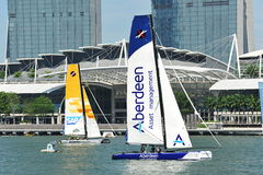SAP Extreme Sailing Team racing Team Aberdeen Singapore at Extreme Sailing Series 2013. SAP Extreme Sailing Team racing Team Aberdeen Singapore at the Extreme royalty free stock images