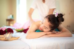 Sap Massage. Masseur doing massage with treatment sugar scrub on Asian woman body in the Thai spa lifestyle, so relax and luxury. Sap Massage. Masseur doing royalty free stock image