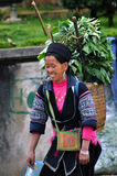 Black Hmong woman carrying fresh herbs, Sapa, Vietnam Royalty Free Stock Images