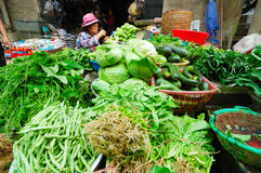 Sapa Market. SAPA, VIETNAM - JULY 7: a woman is at her vegetable stall at Sapa morning market on July 7, 2009. Sa Pa is a mountain town in Vietnam and home to a Stock Photo